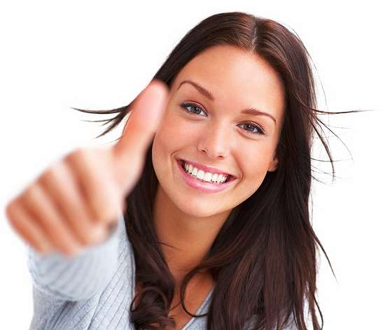 Portrait of attractive young female showing a thumbs up on white background
